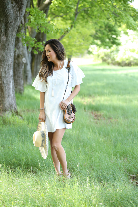 White-Maison-Labiche-dress-Salmagundi-straw-hat-tiffany-pearl-necklace-looking-to-side_1307