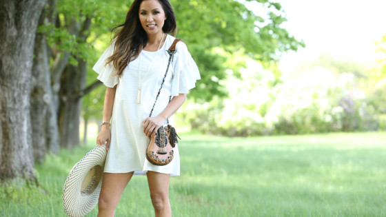 White-Maison-Labiche-dress-guitar-purse-smiling-front-view_1330