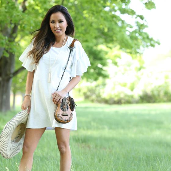 White-Maison-Labiche-dress-guitar-purse-smiling-front-view_1330