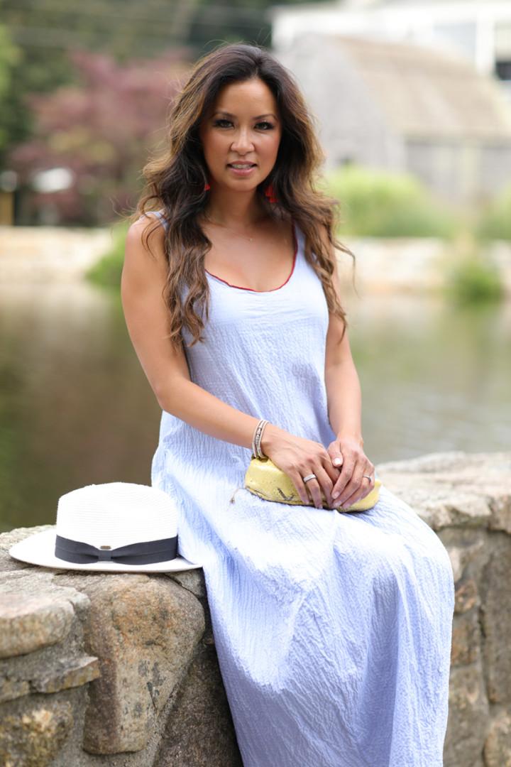 Sitting-on-stone-wall-in-blue-poplin-dress
