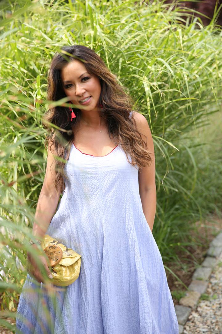 blue-poplin-dress-in-grassy-background